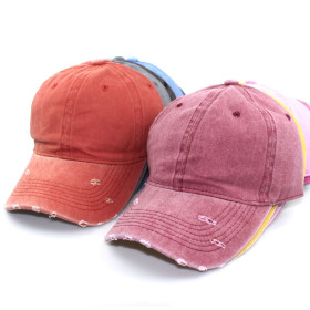 Washed baseball cap with holes, made in autumn and winter