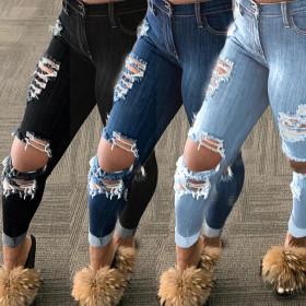 Denim pants with holes