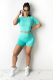 Tight, athletic, navel exposed, two piece set