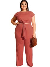 Plus size knoop crop top en broek set
