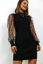 Mini robe noire avec manches en maille pailletée