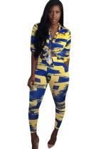 Conjunto de blusa y pantalón africano amarillo y azul