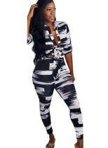 Conjunto de blusa y pantalón africano blanco y negro