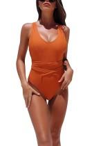 Einfarbige einteilige bescheidene Badebekleidung mit V-Ausschnitt