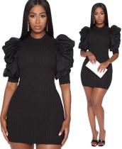 Sexy schwarz gestricktes figurbetontes Kleid mit Pop-Ärmeln