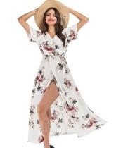 Vestido largo envuelto con estampado floral de verano