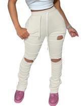 Pantalones rasgados de verano con cordones transparentes