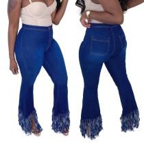 Jeans acampanados con borlas y cintura alta