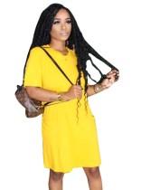 Vestido de camisa de bolsillo con cuello en O de color liso de verano