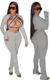 Sexy graues Langarm-Reißverschlussoberteil und gestapelte Hosen