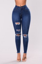 Jeans rasgados ajustados de cintura alta sexy