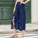 Pantalones con volantes y cintura alta con lunares blancos y azules