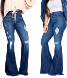 Elegantes jeans azules de cintura alta con rip flare