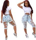 Pantalones cortos de mezclilla rasgados de cintura alta con lavado azul elegante