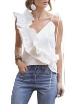 Camisa blanca sin mangas con volantes irregulares