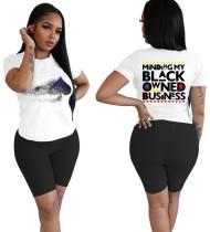 Camicia con stampa sexy e pantaloncini da motociclista trasparenti