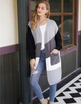 Abrigo suéter largo contraste occidental