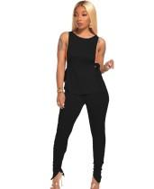 Set camicia sexy annodata nera e pantaloni impilati