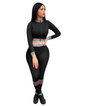 Top corto negro sexy de manga larga con cremallera y pantalones a juego