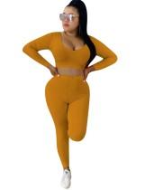 Conjunto de legging de cintura alta y top corto sólido de manga larga de punto sexy