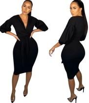 Zwarte sexy midi-jurk met diepe V-hals en popmouwen