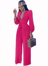 Effen kleur elegante jumpsuit met lange mouwen en riem