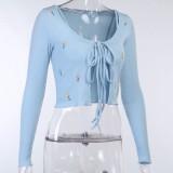 Chaleco corto azul floral otoñal y cárdigans a juego