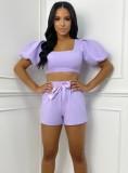 Conjunto de top corto y pantalones cortos cuadrados a juego en color liso