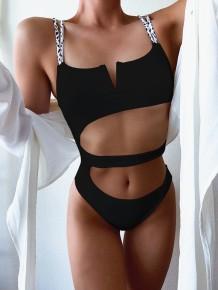 Einteilige Badebekleidung mit ausgeschnittenem Riemen