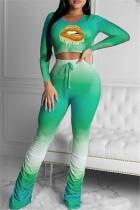 Top corto autunnale con gradiente abbinato e set di leggings impilati a vita alta