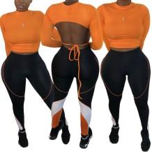 Top corto autunnale sexy aperto sulla schiena e leggings abbinati