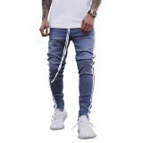 Jeans strappati alla moda da uomo