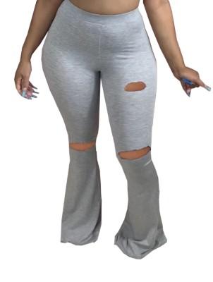 Pantalones acampanados rasgados de cintura alta de color sólido