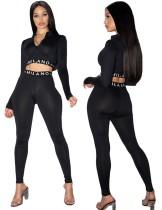 Top corto a due pezzi con stampa sportiva e set di leggings a vita alta