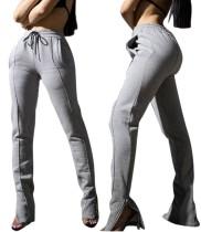 Pantalones de chándal grises con cordón con cremallera en la parte inferior