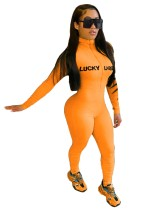 Sportfitness print jumpsuit met lange mouwen en rits