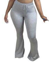 Pantalon évasé taille haute avec cordon de serrage de couleur unie