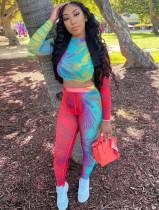 Top corto aderente colorato e pantaloni sexy in due pezzi