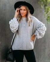 Suéter suelto liso liso con cuello redondo y mangas detalladas