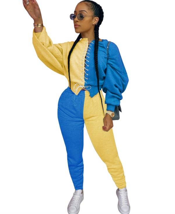 Top corto e pantaloni autunnali con lacci in colore a contrasto