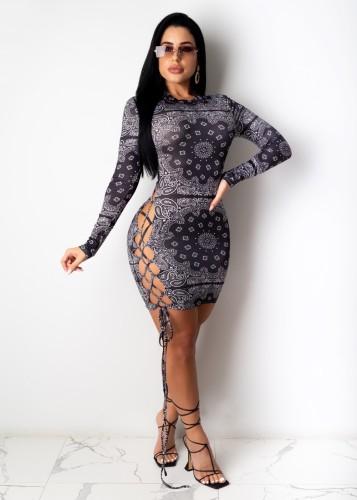 Sexy zwarte bodycon-jurk met vetersluiting en lange mouwen