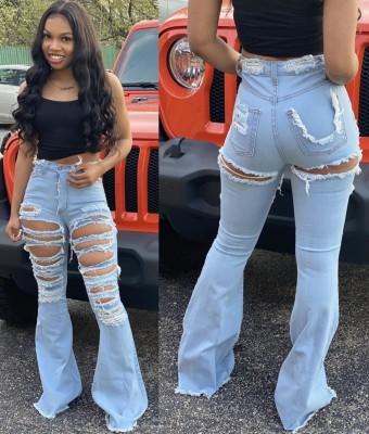 Jeans svasati strappati a vita alta azzurri alla moda