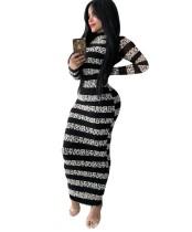 Vestido largo curvo con estampado de rayas otoñales y mangas completas