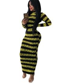 Lange, ronde jurk met herfststrepen en volle mouwen