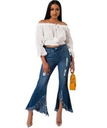 Stijlvolle blauwe flare jeans met hoge taille en kwastjes