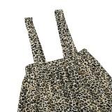 Insieme della camicia scava fuori bianca autunnale della ragazza dei bambini e della gonna della bretella leopardata