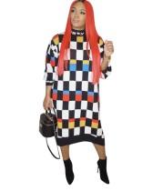 Robe chemise longue géommétrique colorée automne Afrique
