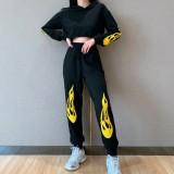 Sudadera con capucha y pantalón negro estilo callejero de otoño