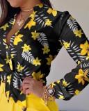 Blusa elegante anudada con estampado floral otoñal