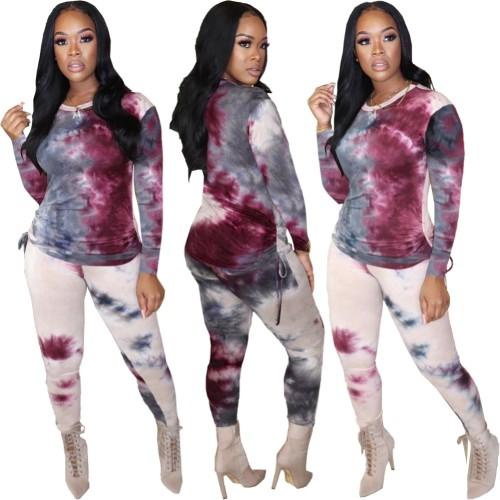 Conjunto de calças e camisa tie-dye outono África